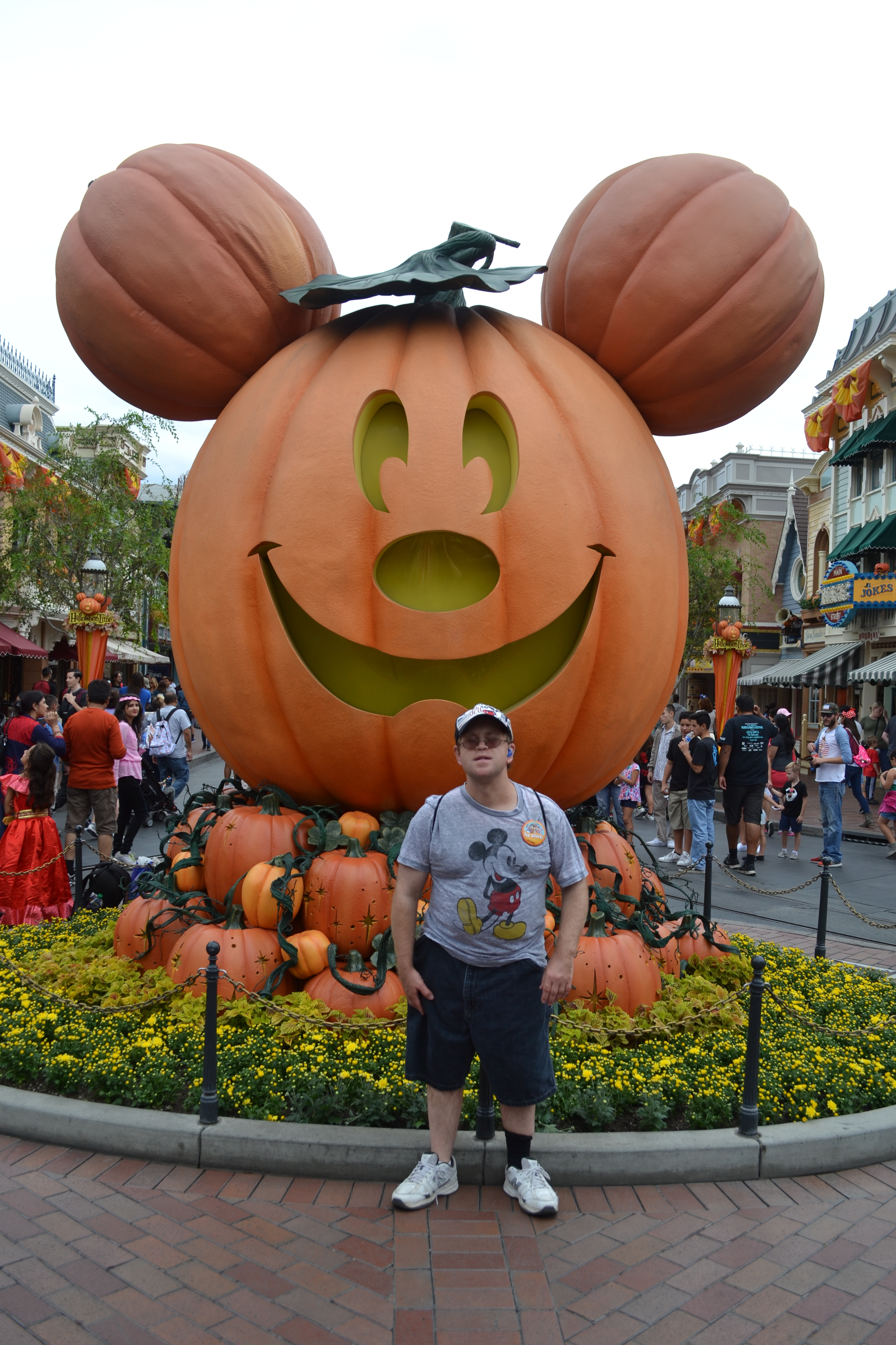 Vacationer standing in front of giant Micky Mouse