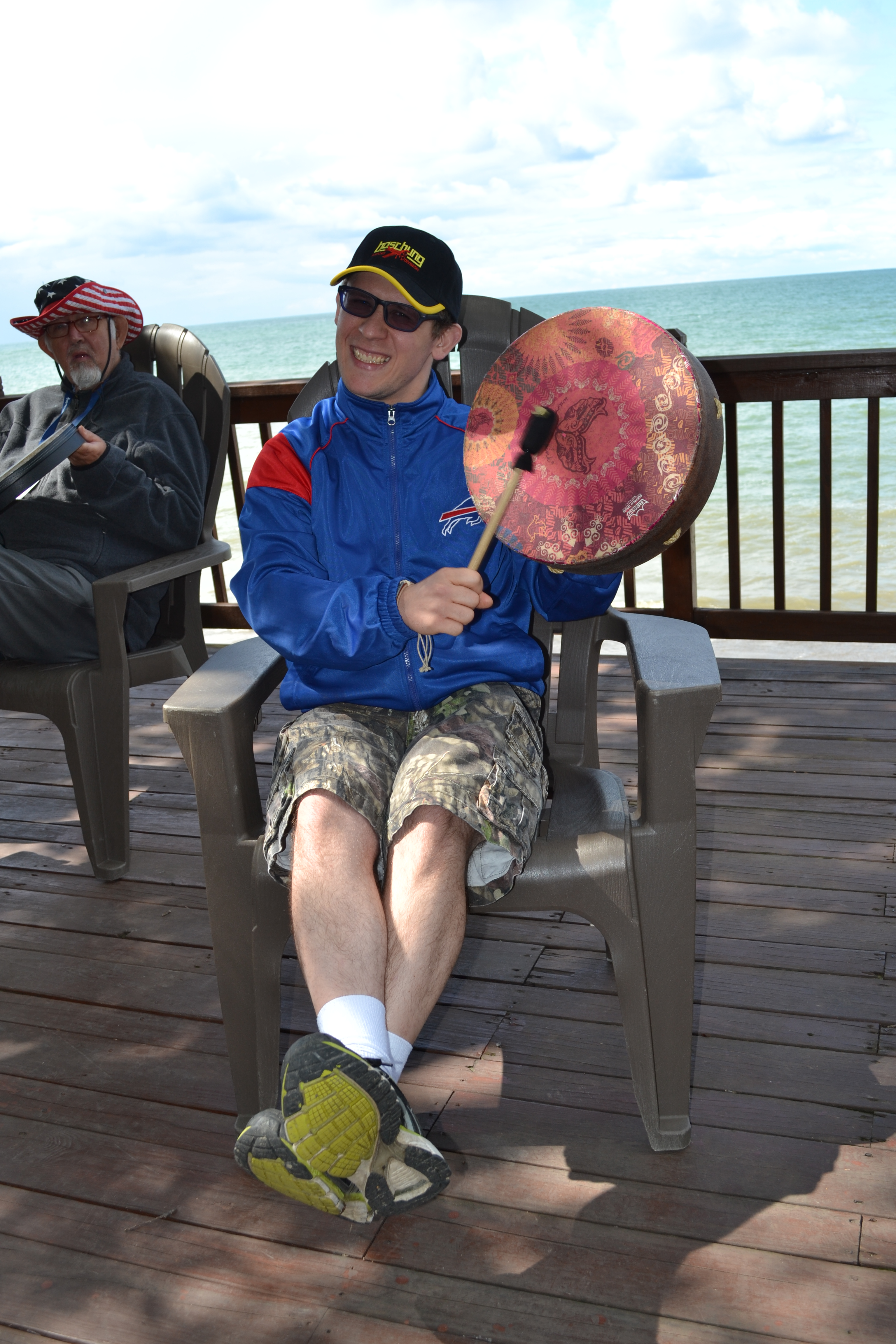 Vacationer participating in a Drum Circle