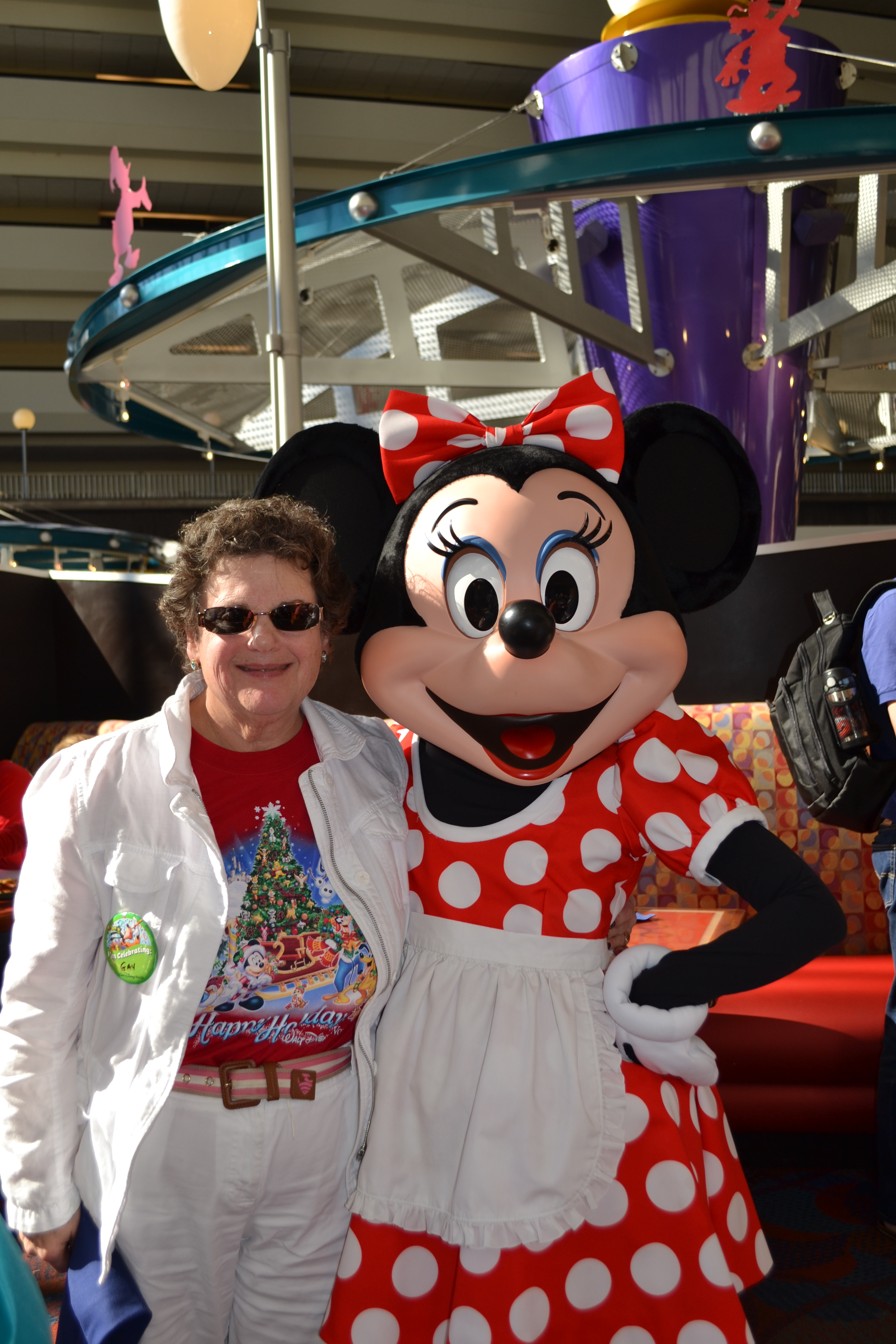 Vacationer posing with Minnie Mouse