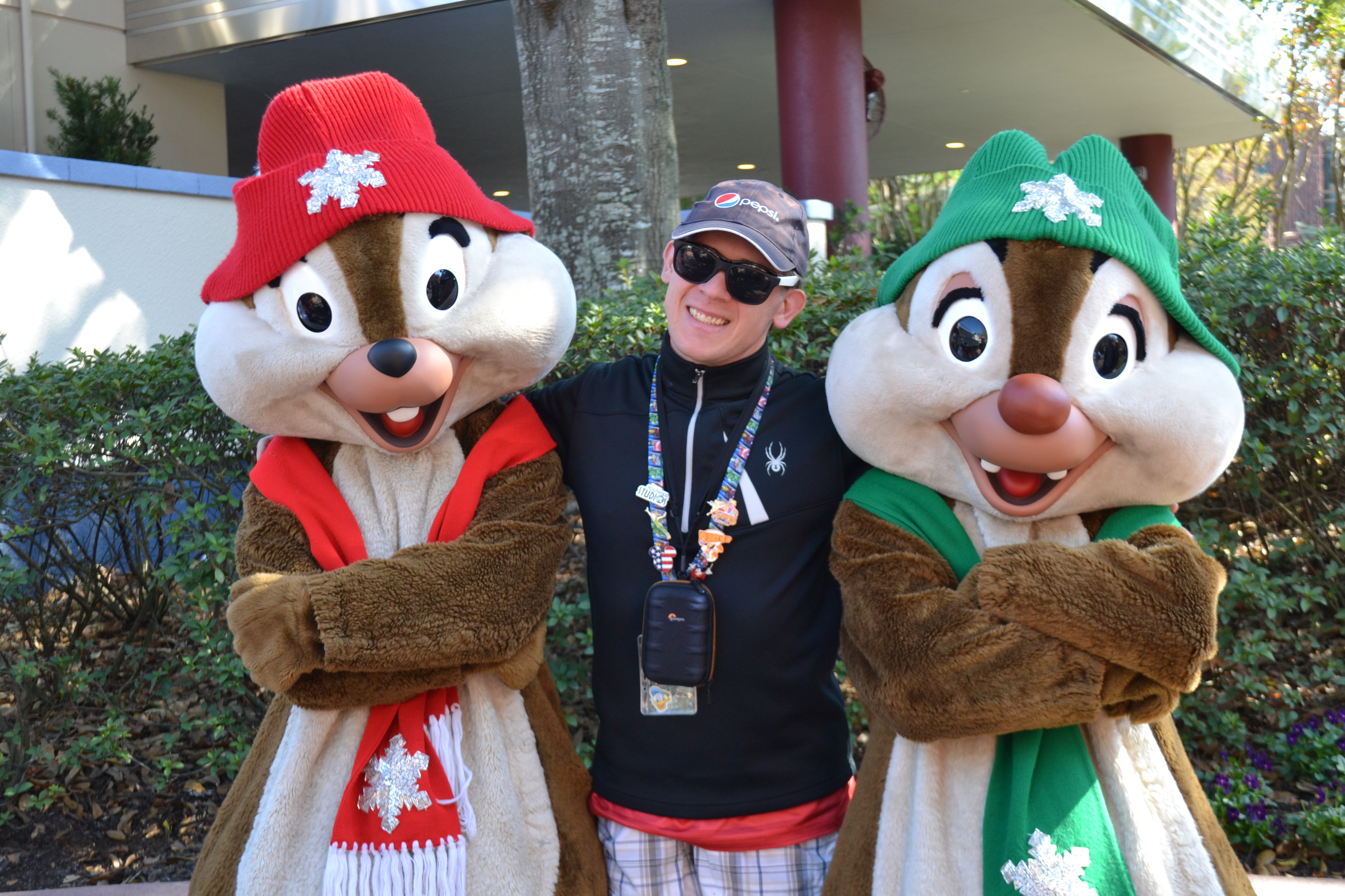 Vacationer posing with Chip and Dale