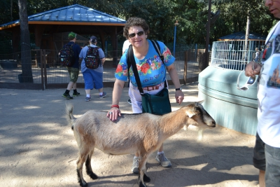 Vacationer petting a goat