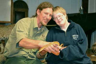EarthSpirit staff showing vacationer a snake at People and Places' Annual Fall Getaway.